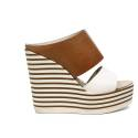 Zoe Italy sandalo donna con zeppa alta color bianco e cuoio articolo MIC100/02